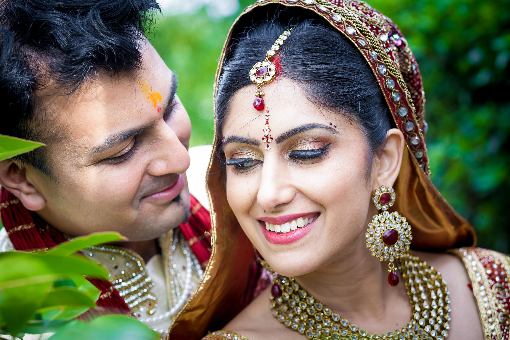 Asian Wedding Photographer couple posing with a smile