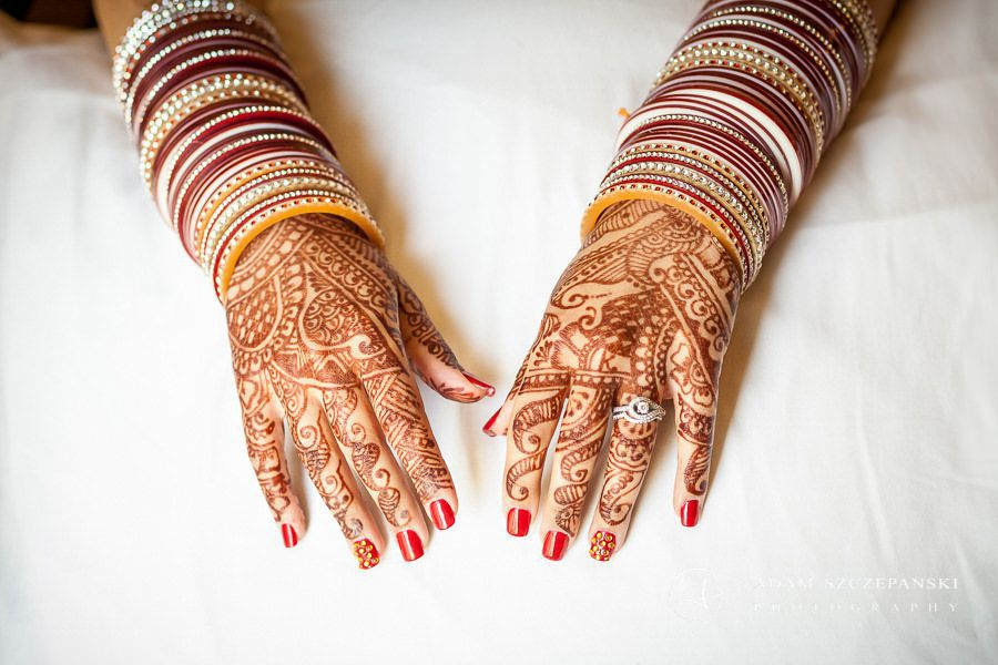 hands of the asian bride with wedding tatoos