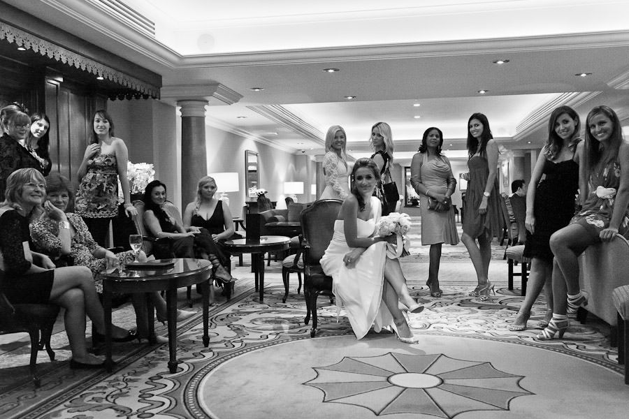 bride Nadia and her bridemaids posind to the group black and white wedding photo in lancaster hotel