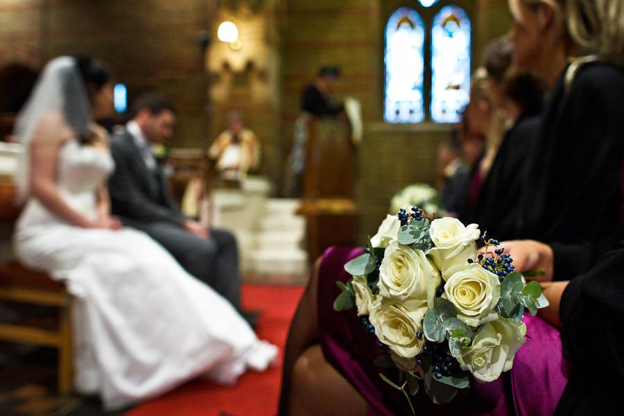 wedding ceremony moment and the flowers on the first plan