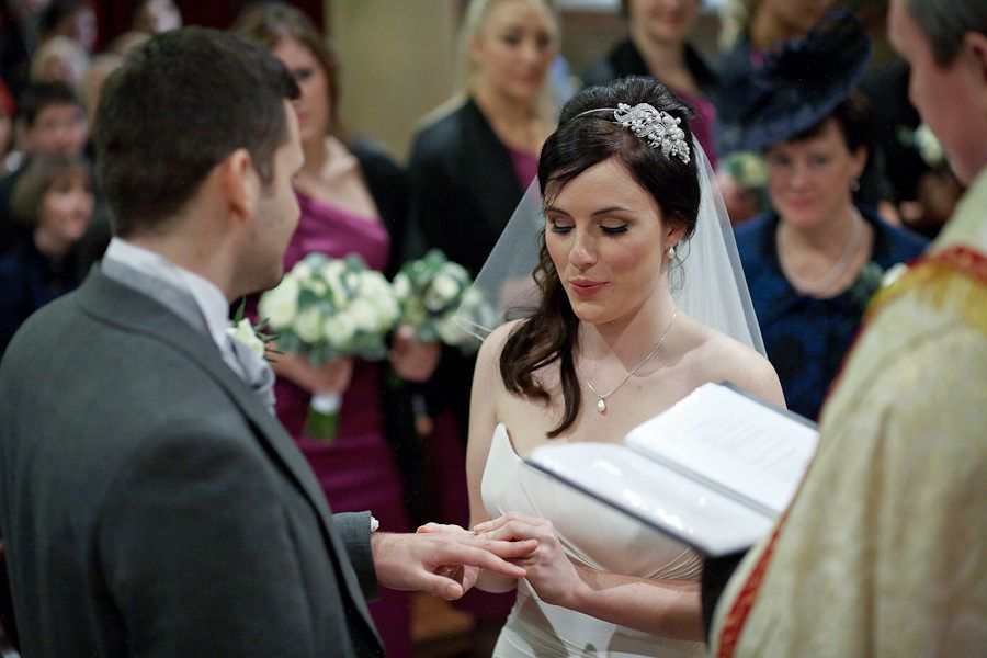 wedding oaths in the church during the wedding ceremony of hannah and oliver