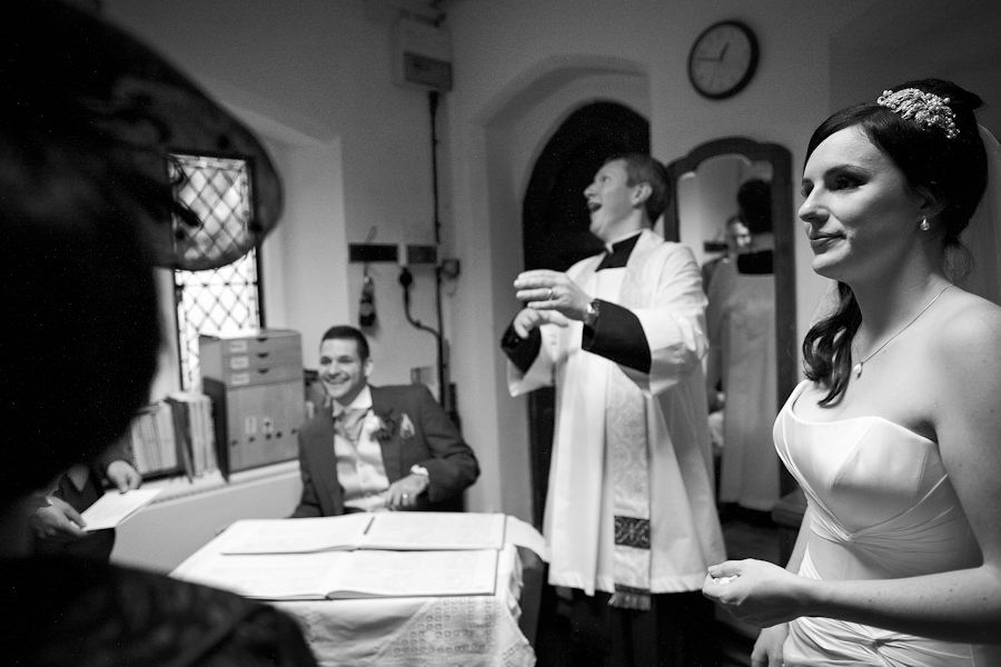 black and white photography of the married couple hannah and oliver and the priest
