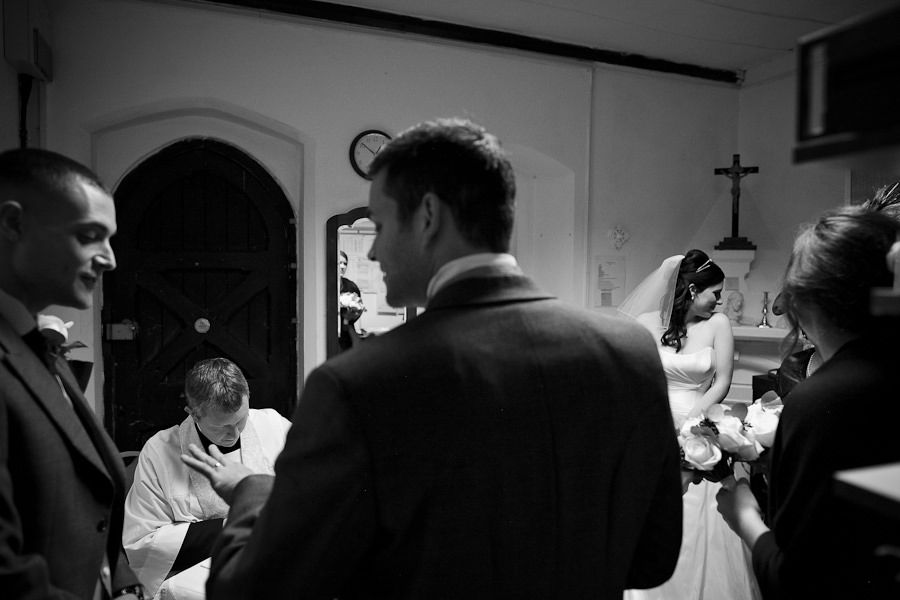 documentary style wedding photography in the church in teddington