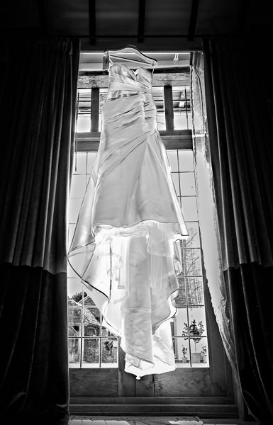 wedding dress hanging from the window