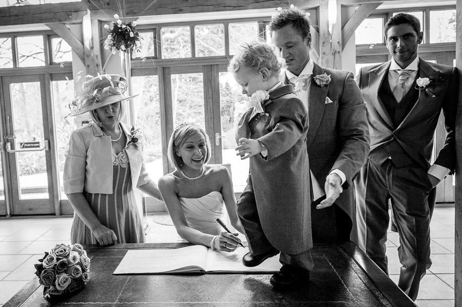 bride Nicole signs the wedding bill