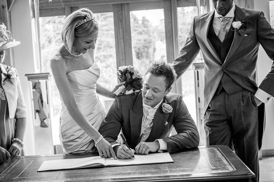 groom signs the wedding bill