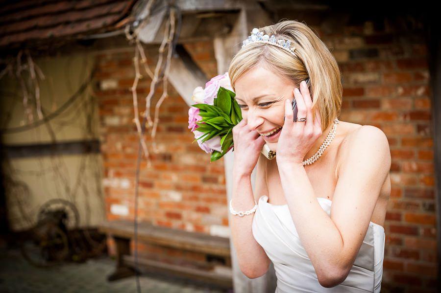 happy bride Nicole is talking on the phone
