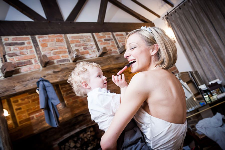 bride holds the baby in her arms