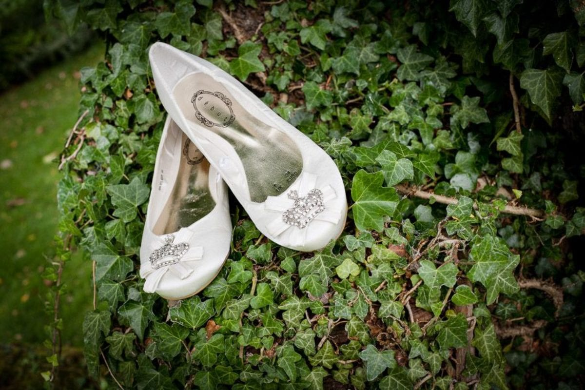white wedding shoes on the grass