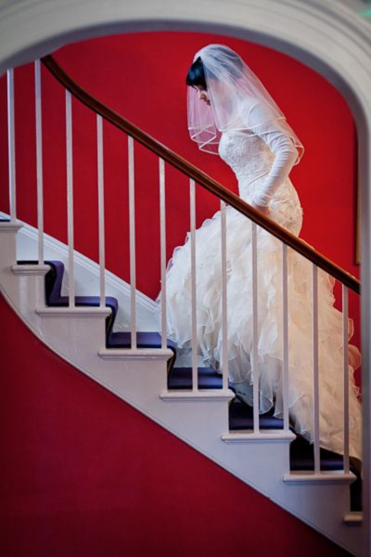 the bride steps up the stairs