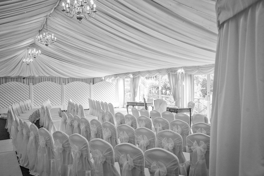 place for wedding full of white chairs