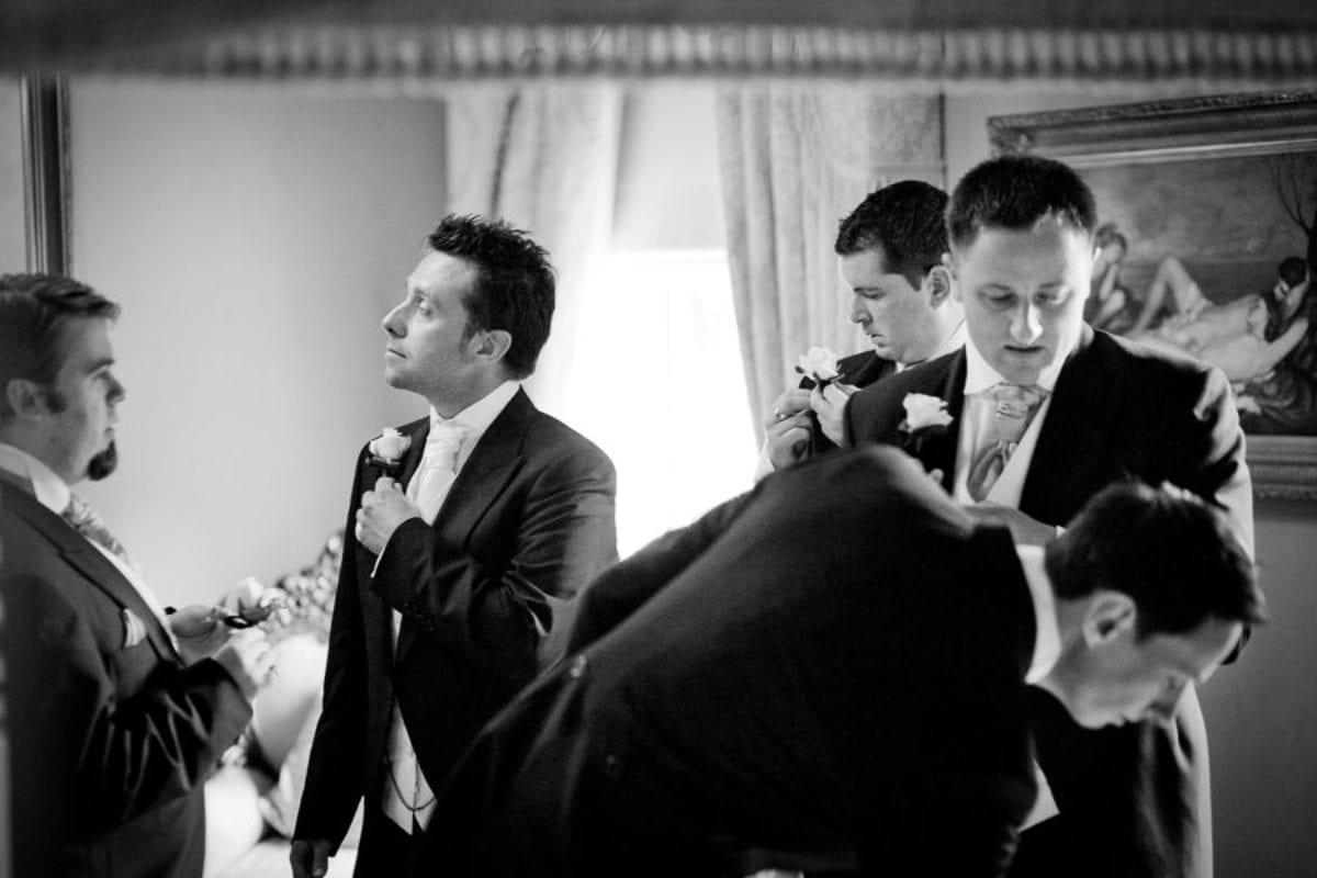 groomsmen preparing for the weddding ceremony