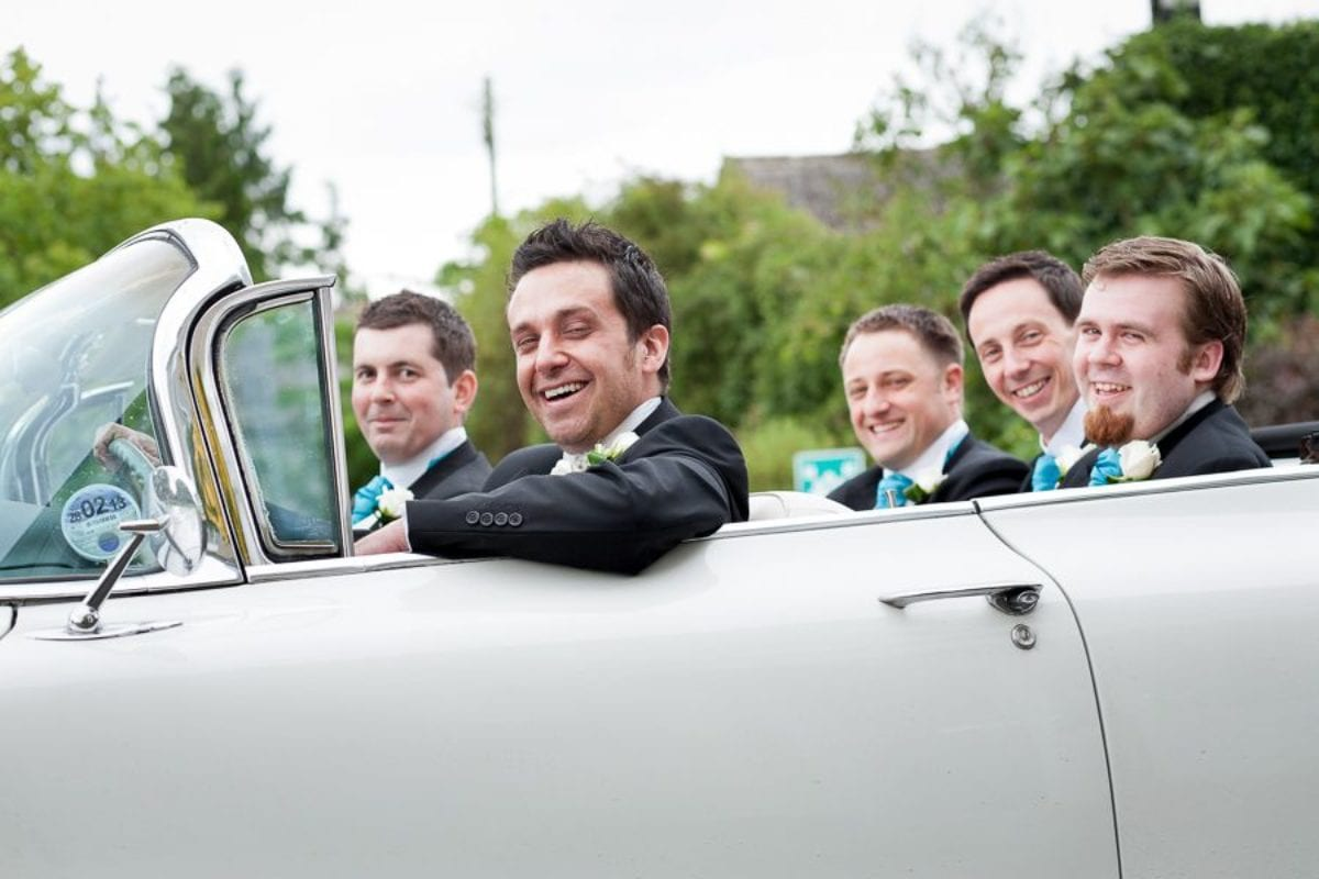 groom and groomsmen in the car