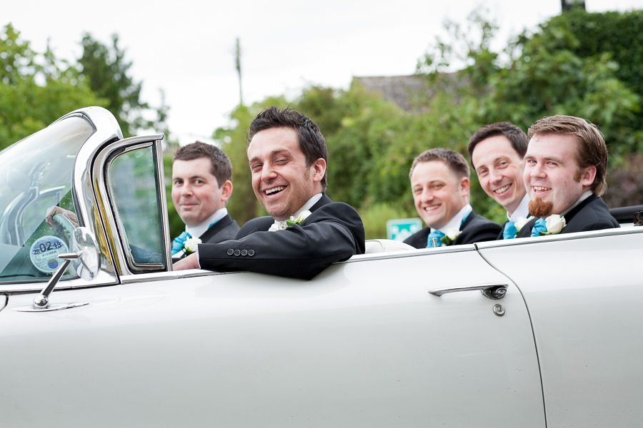 groomsmen in the wedding car