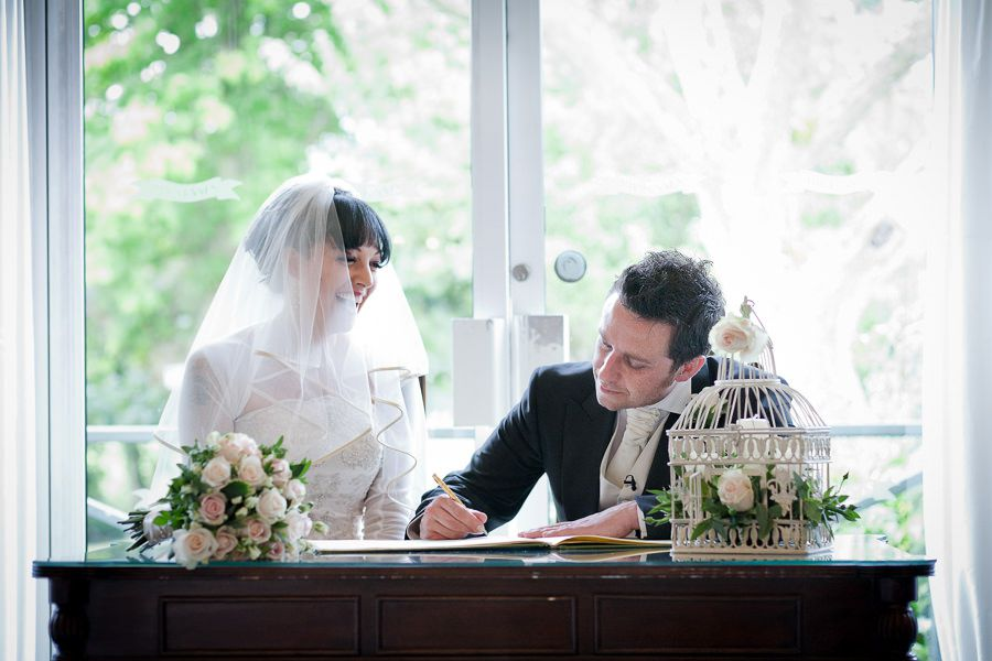 young couple sign the wedding certificate