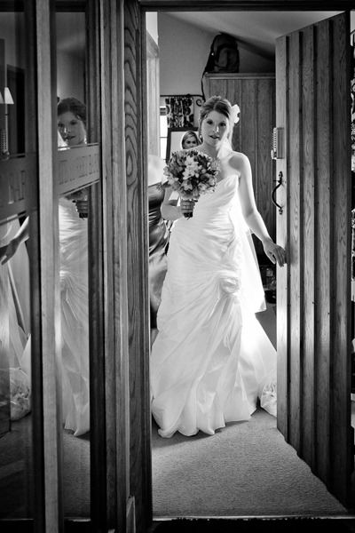 bride kristen wears the traditional wedding dress