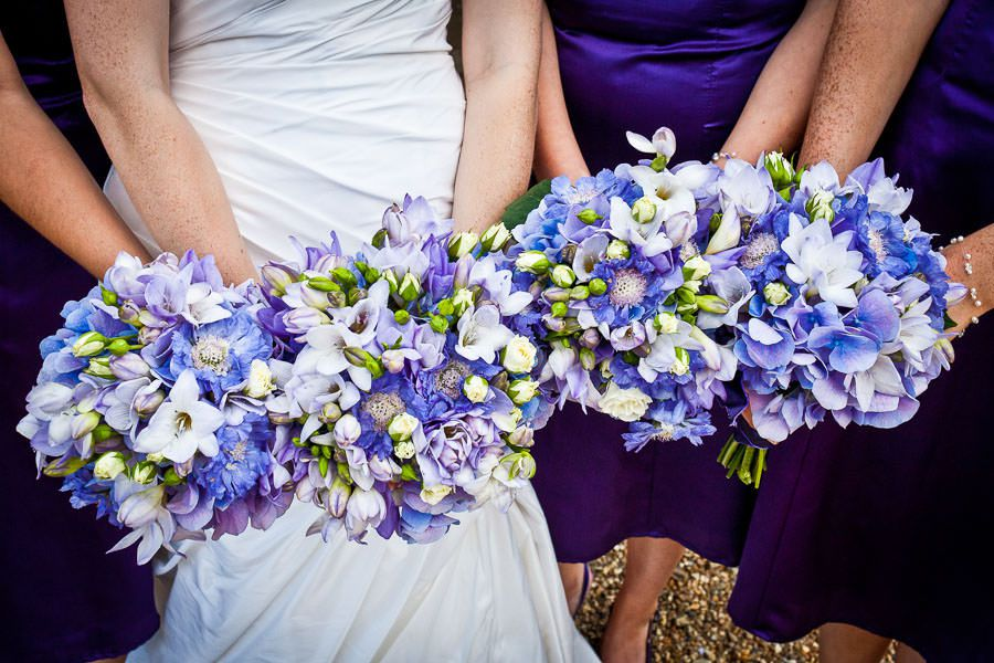 blue and white flowers of the bridesmaids