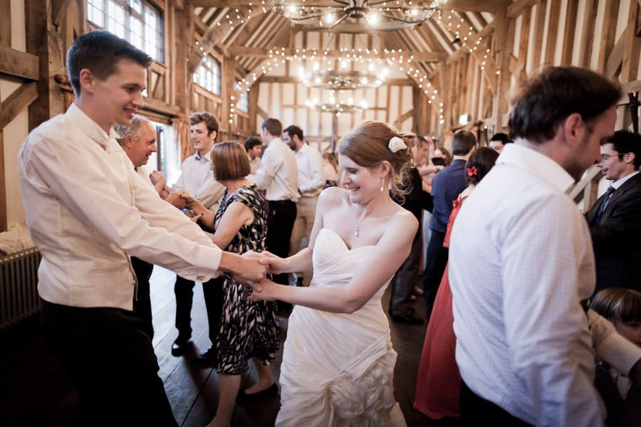 married couple and their guests dancing at the wedding party in surrey