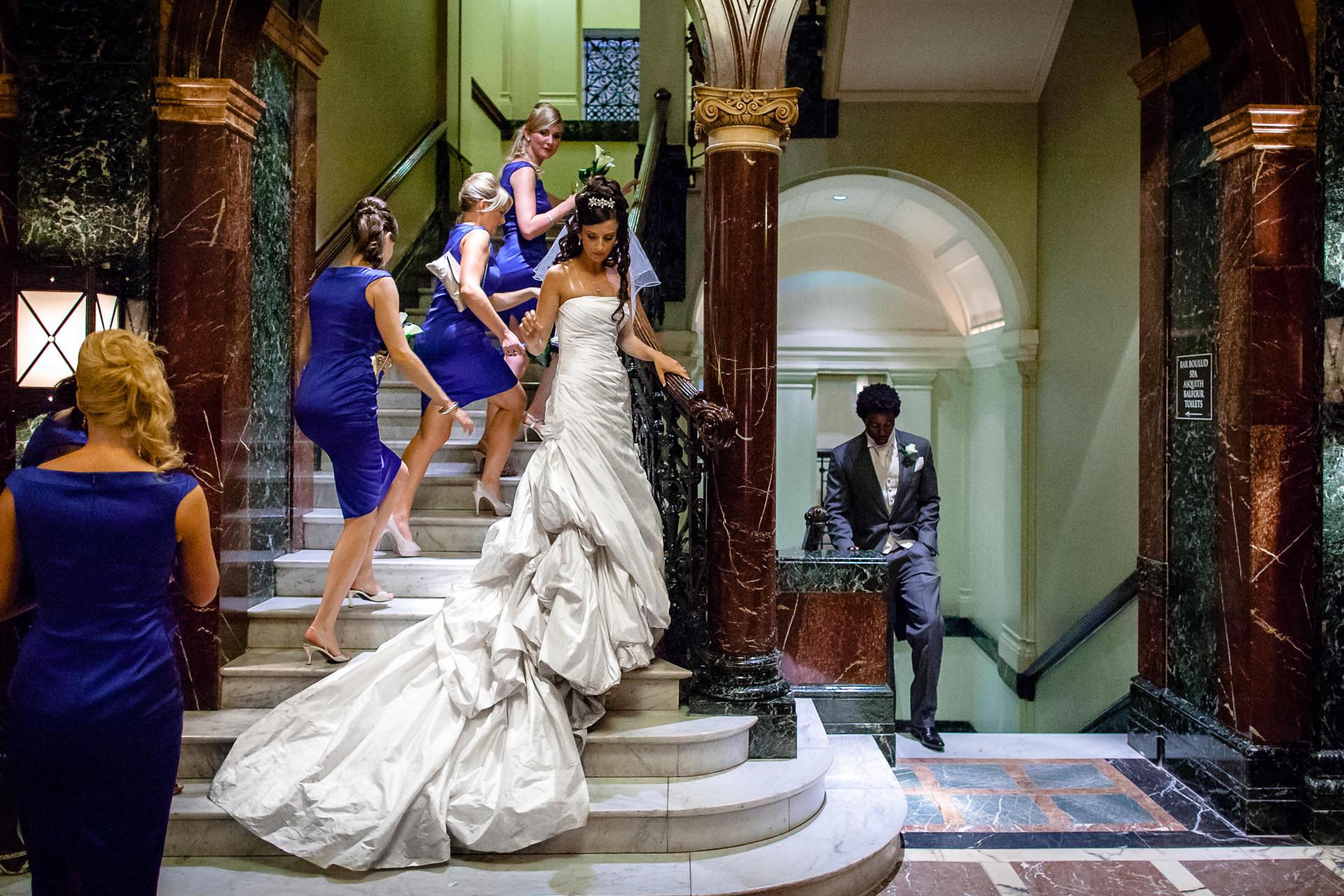 Mandarin Oriental Hotel London Wedding Photographer bride and groom walking the stairs