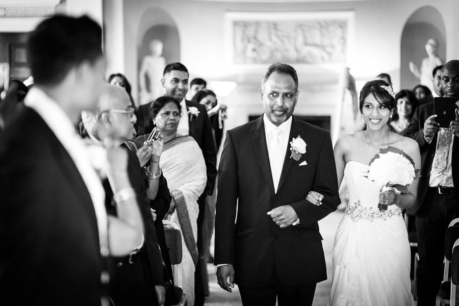 bride sindu arm in arm with her father