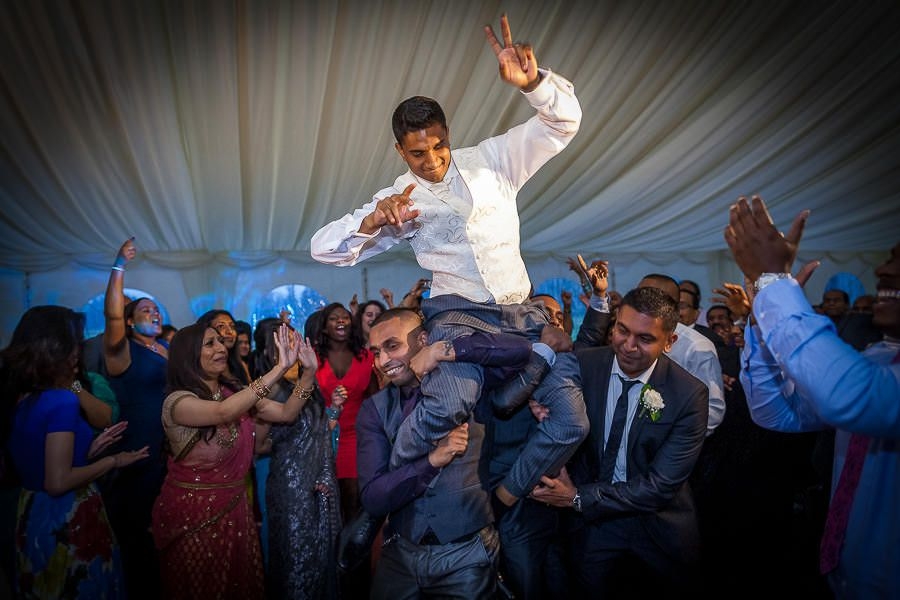 groom pav and wedding guest having fun at the party
