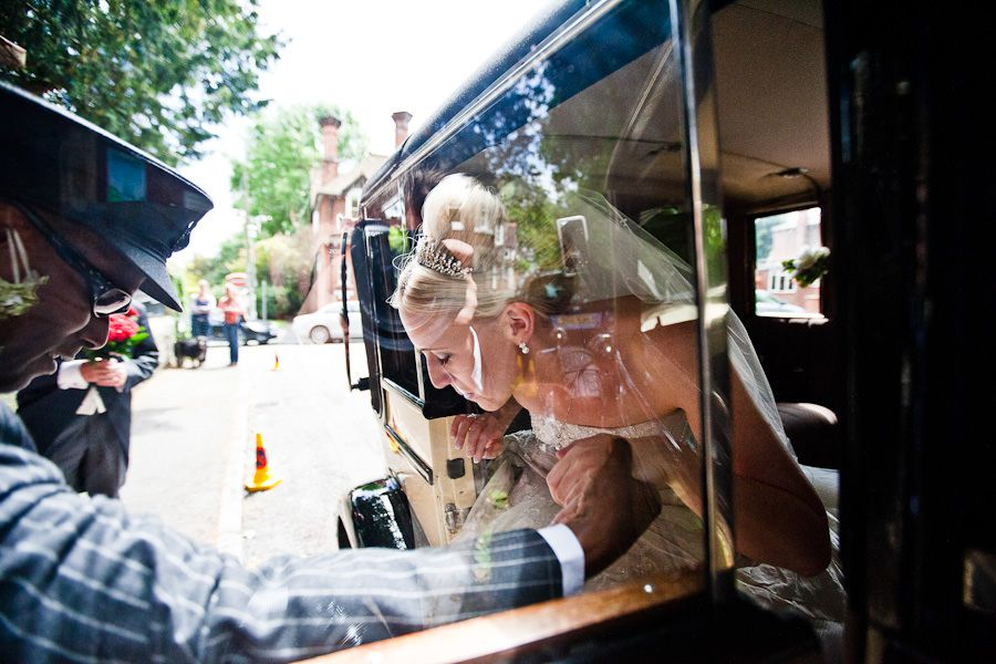 bride Emma gets out of the car