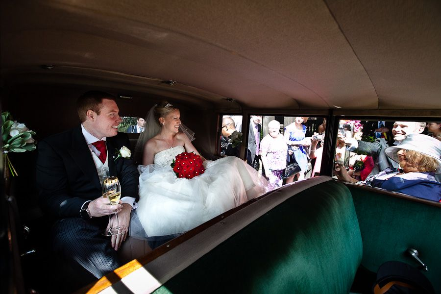 married couple Emma and Mat in the car just after the wedding ceremony