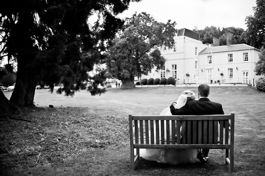 couple Emma and Matt sitting on the bench in berkshire's park
