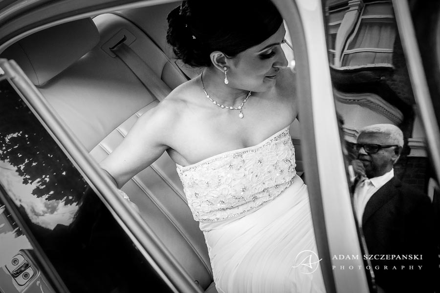 bride in wedding dress in the car