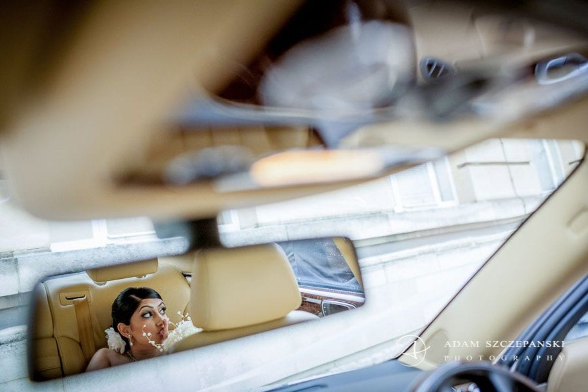 Wandsworth Town Hall Wedding Photographer reflection in the car mirror of the bride nima
