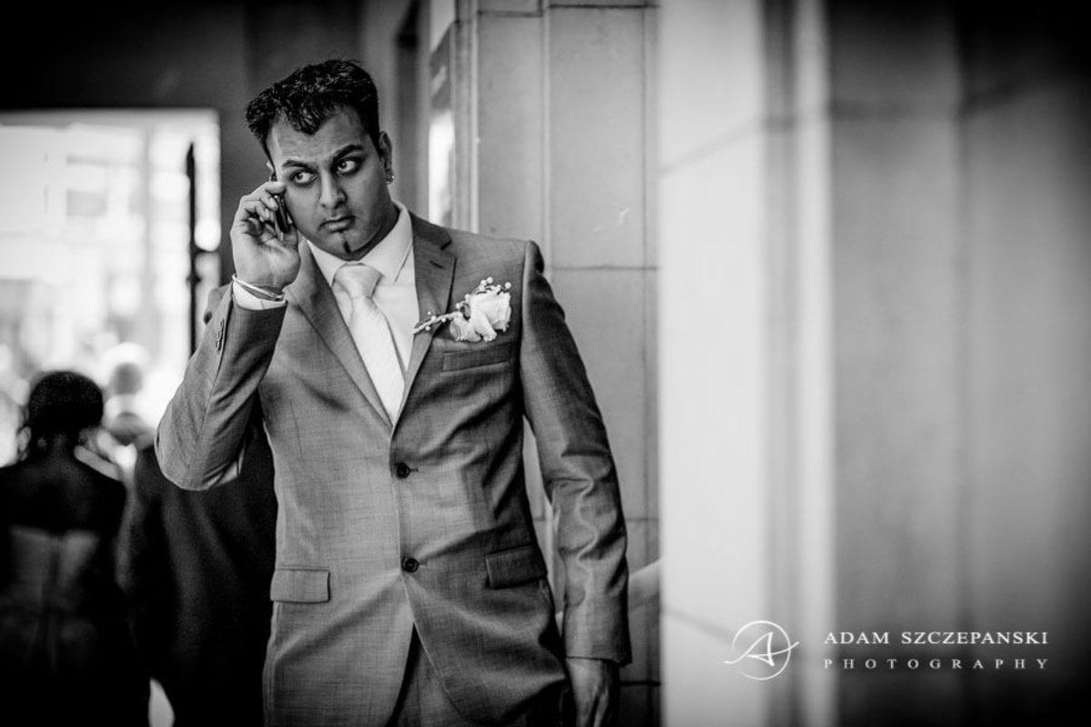 Wandsworth Town Hall Wedding Photographer groom karan talking on the phone