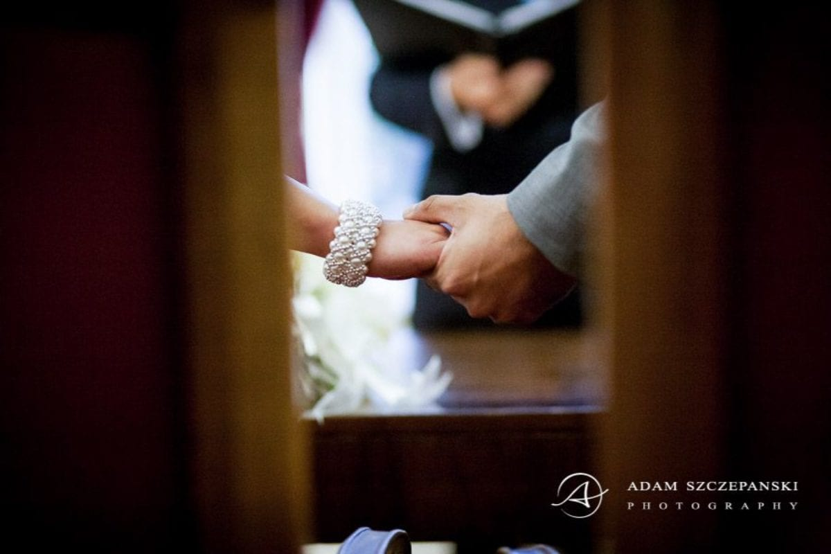 Wandsworth Town Hall Wedding Photographer married couple nima and karan hold their hands