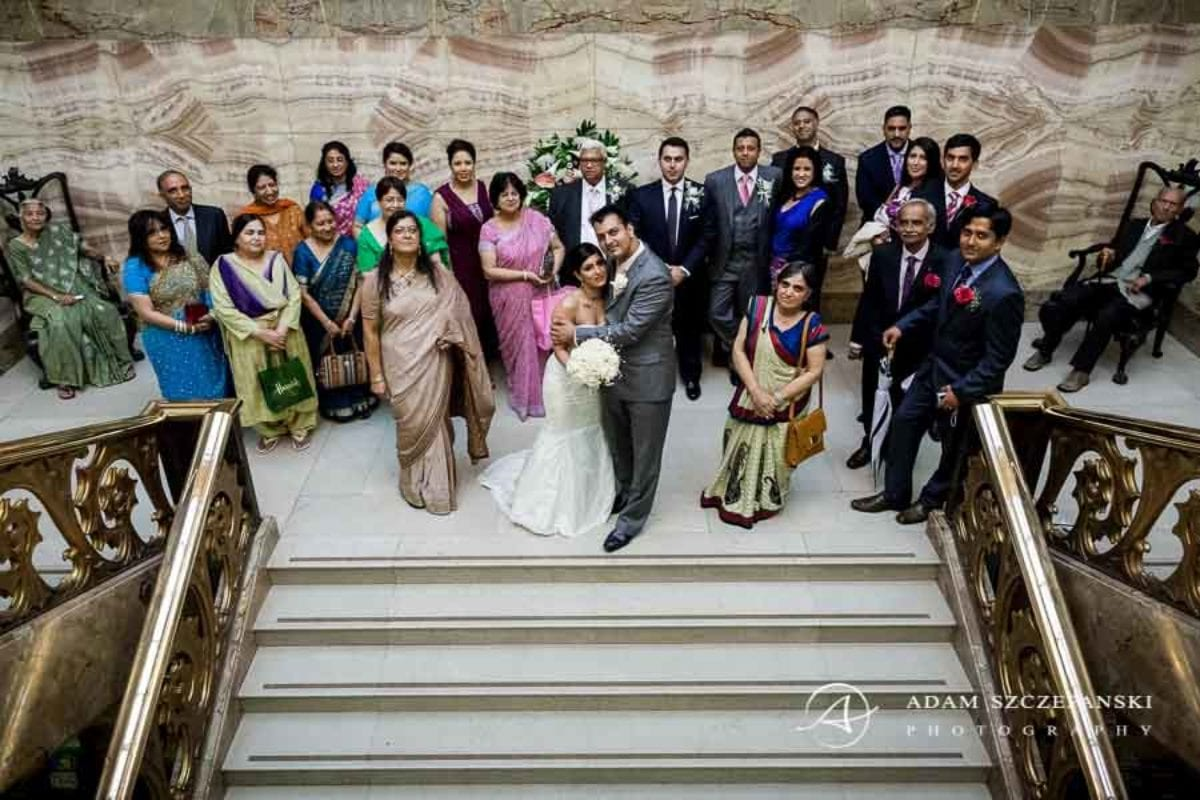 group photography of the married couple and wedding guests on the stairs