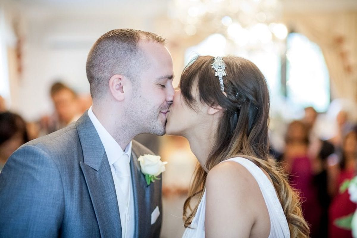 married couple first wedding kiss