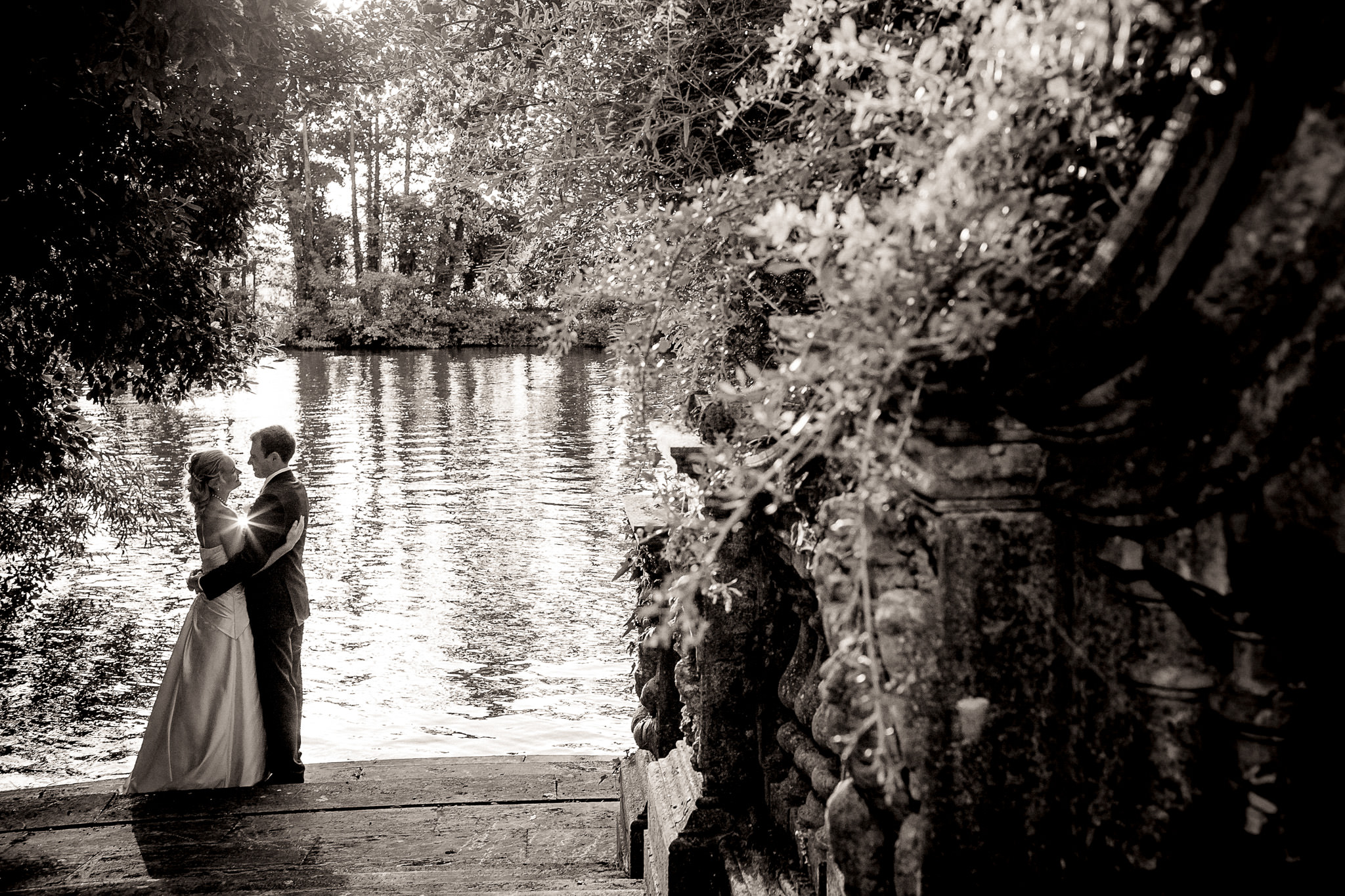 Cliveden House Hotel Wedding Photographer Couple by the river hugging