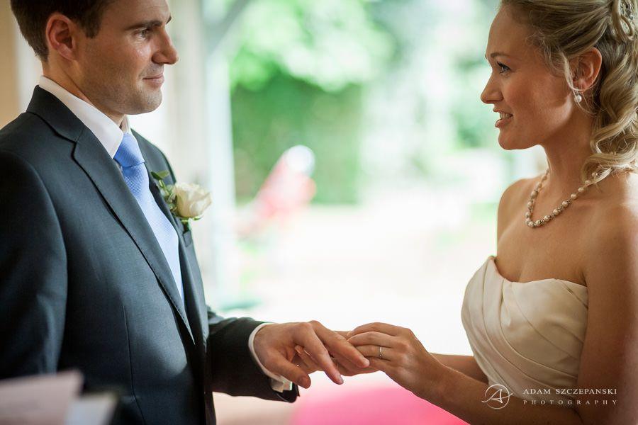 bride caroline put the wedding ring on her husband finger