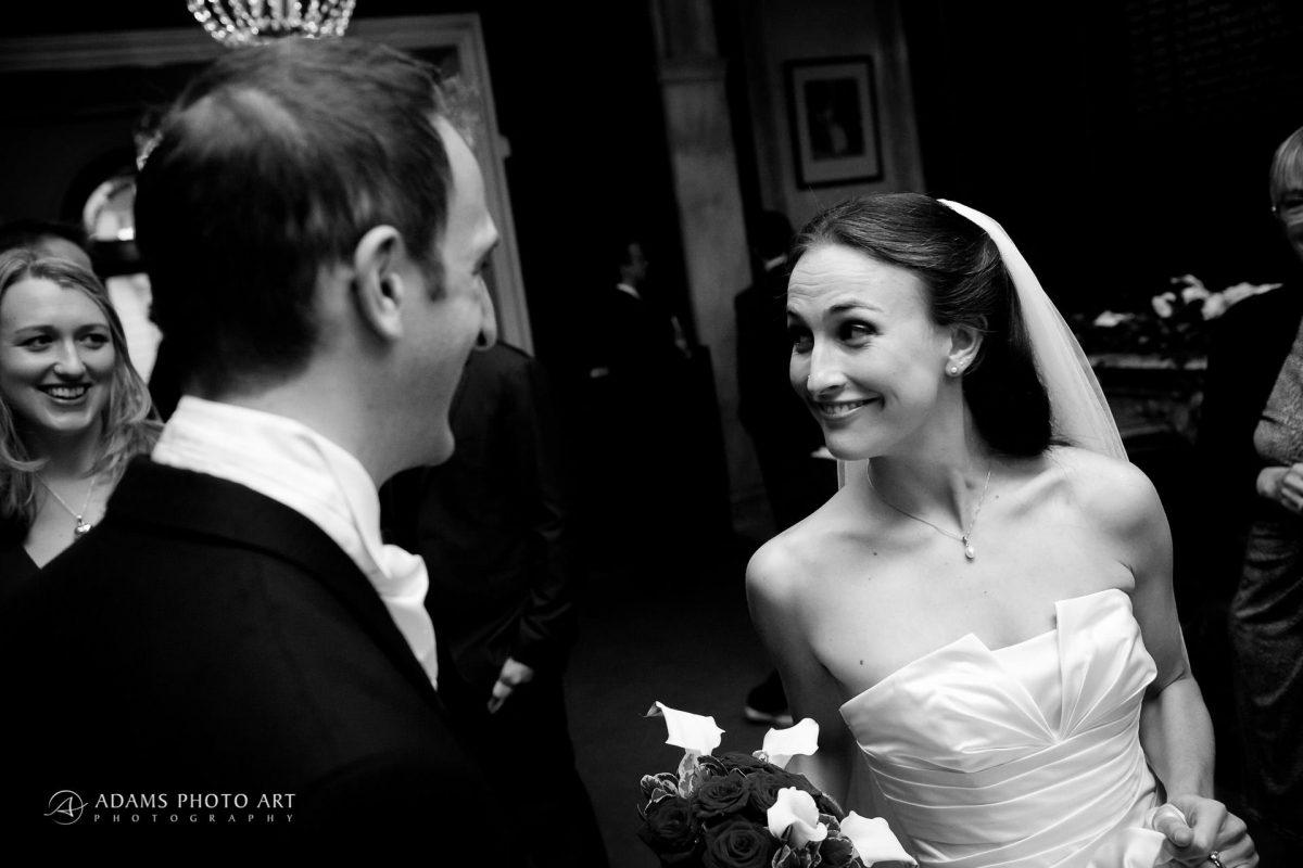 bride rebeca smiles at her husband
