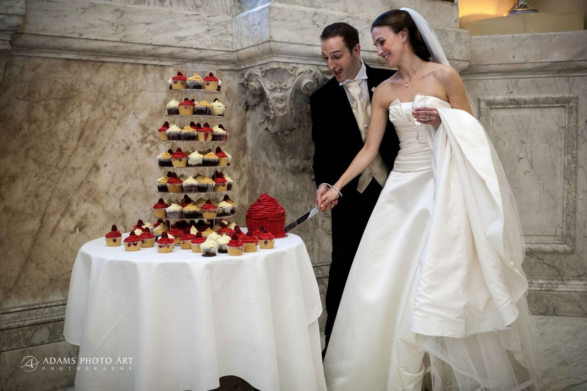 couple cut their wedding cake