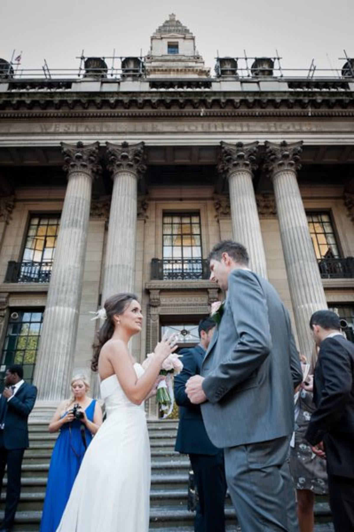 young couple in front of the registry office