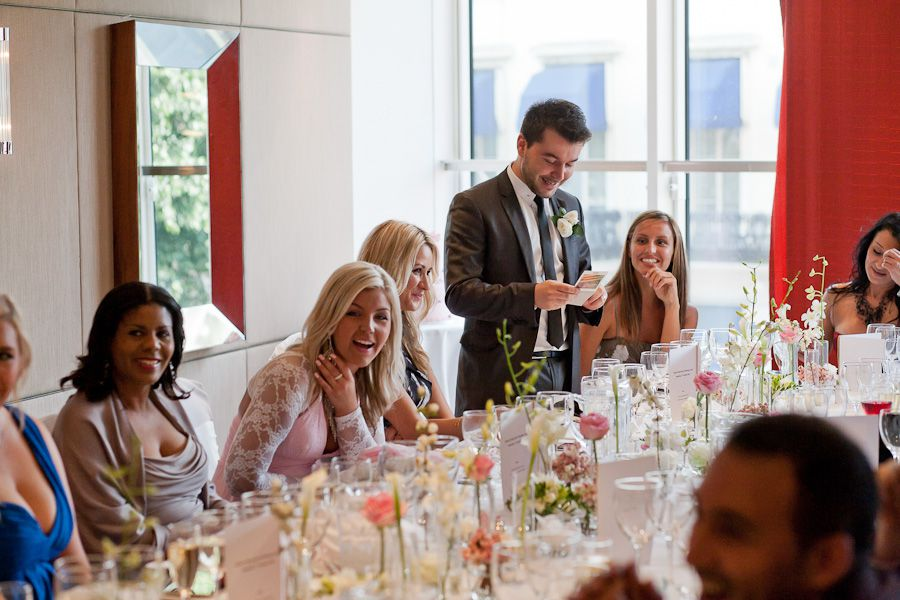 wedding guests sitting on the table at the party