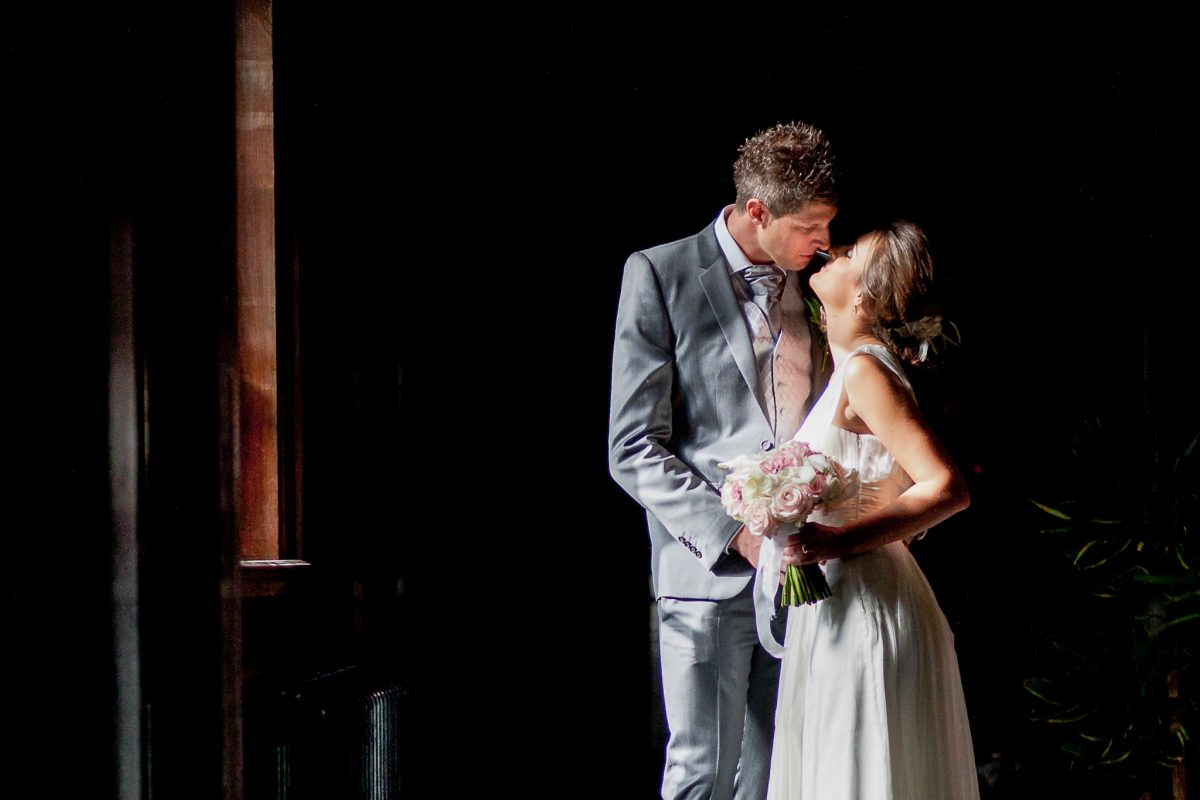 Old Marylebone Town Hall wedding married couple kissing by the window