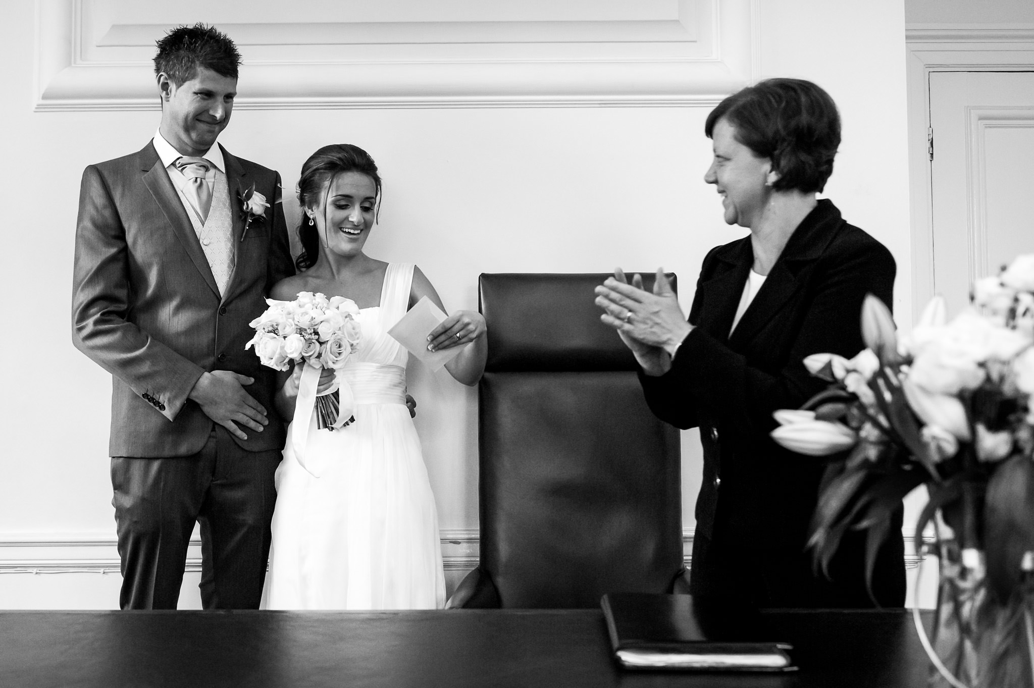 couple receiving the marriage certificate