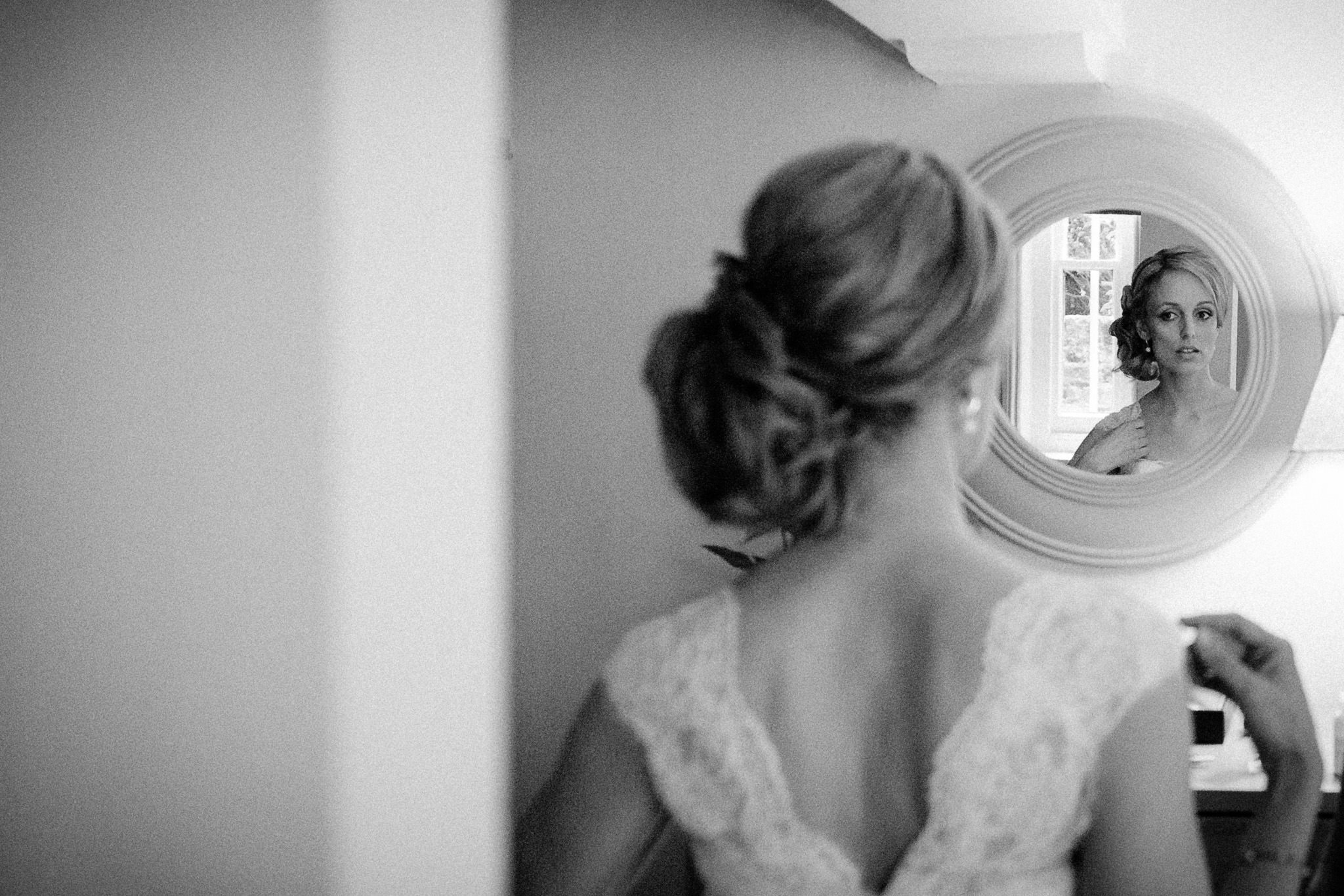 Thames Rowing Club Wedding Photographer portrait of the bride in the mirror