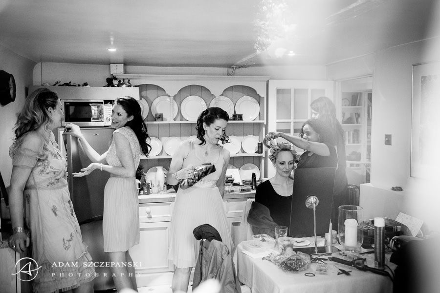 black and white picture captures the happines of the wedding preparations