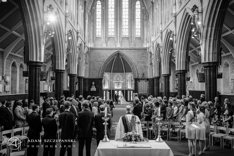 black and white photo of the london church during the wedding ceremony