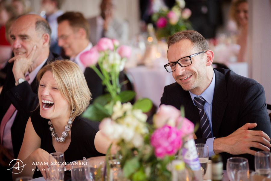 wedding guests laughing at the party