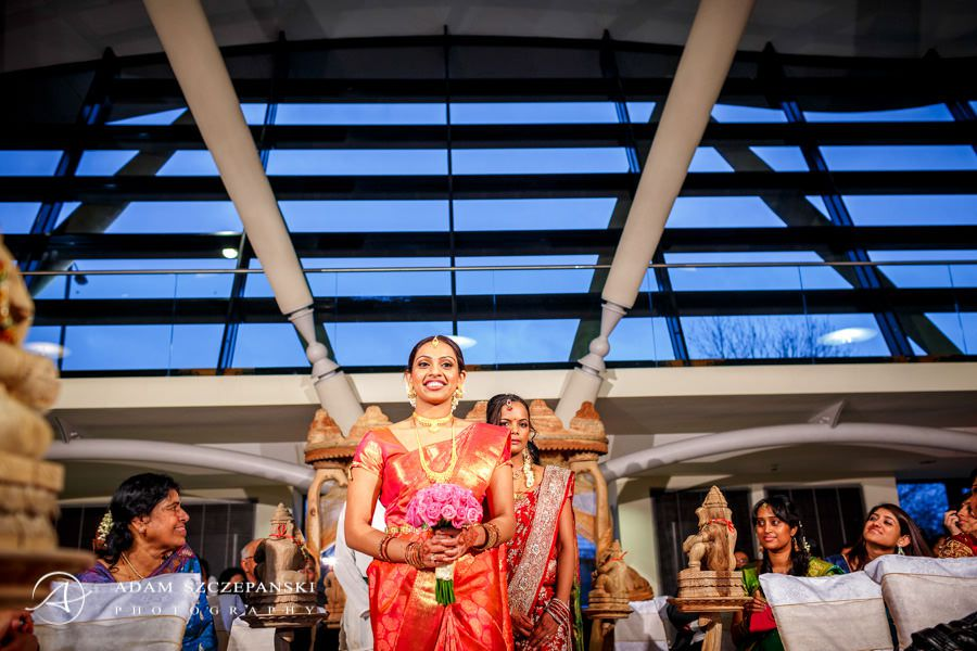 Bride walking Sattavis Patidar Centre in Wembley