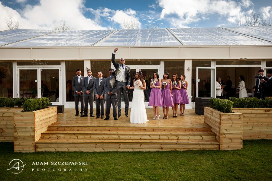 young couple and guest posing to the wedding photo