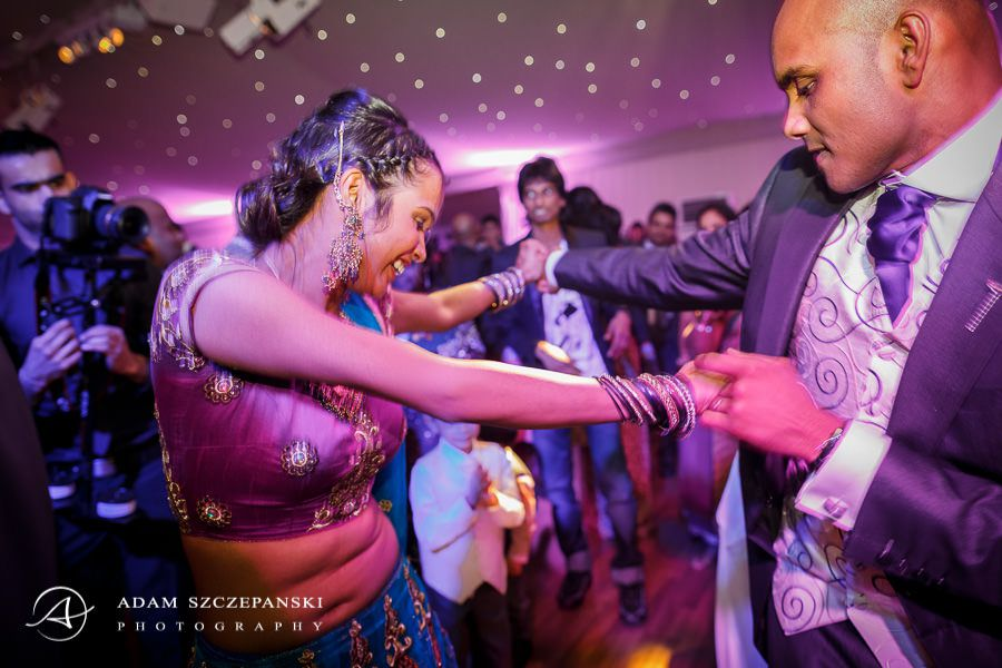 asians dancing on the wedding party
