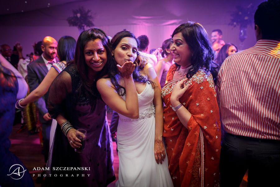 women posing during asian wedding in painshill park